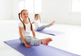 children girls doing yoga and gymnastics in gym - 206244027