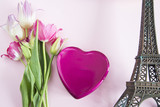 Romantic background with eiffel tower, gift box shape heart and bouquet of tulips