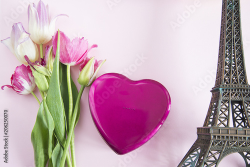 Fotobehang Eiffeltoren Romantic background with eiffel tower, gift box shape heart and bouquet of tulips
