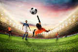 Soccer striker hits the ball with an acrobatic bicycle kick. 3D Rendering - 206250246
