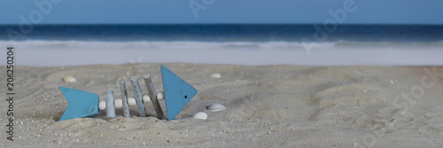 Decorative wooden fish on the beach, panorama - 206250204