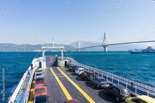Traveling by ferry boat of Rio at Patra, Greece. Rio- Antirio cable stayed bridge on the background