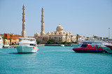 Seascape with motor yachts in marina. View of mosque  in the  background. Hurghada, Egypt - 206257810