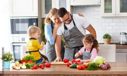 happy family with children preparing vegetable salad - 206265015