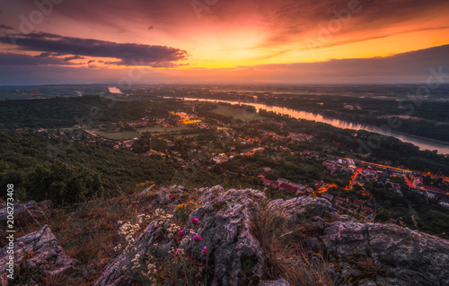 Foto Murales View of Small City of Hainburg an der Donau with Danube River as Seen from Rocky Hundsheimer Hill at Beautiful Sunset