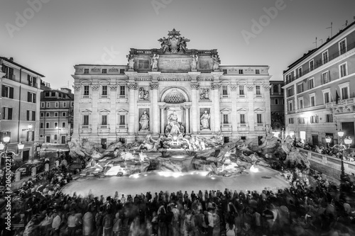 Rome Trevi Fountain or Fontana di Trevi at dusk, Rome, Italy. Trevi is the largest Baroque, most famous and visited by tourists fountain of Rome. Black and white image.