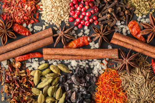 Aromatic Indian spices on a gray slate background