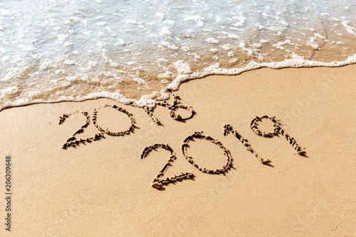 Leinwandbild Motiv New Year 2019 replace 2018 on the sea beach concept