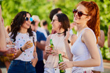 Ginger girl dancing, drinking an having a good time at outdoor party  - 206316684