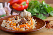 Uzbek pilaf on wooden background - 206319647