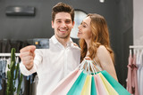 Satisfied young couple shopping for clothes together - 206352232