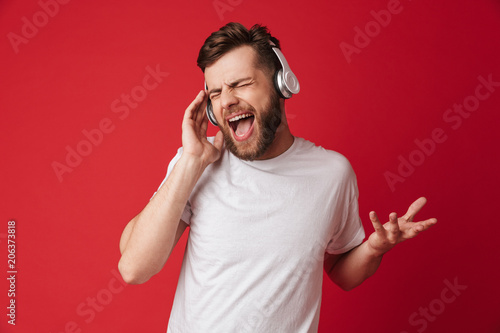Leinwanddruck Bild Emotional screaming young man isolated