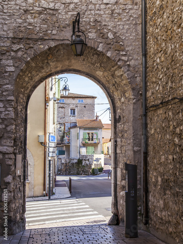 VENCE, FRANCE, on March 8, 2018. The typical urban view characteristic of the small mountain town in Provence. Picturesque stone arch