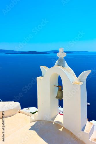 Fotobehang Blauw White belfry in Santorini