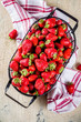 Raw fresh organic strawberry on concrete beige background, copy space selective focus