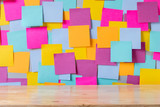 Brown wood table floor and many  color sticky note wall background - 206403605