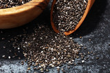 Healthy Chia seeds in a wooden spoon on the table close-up - 206409296
