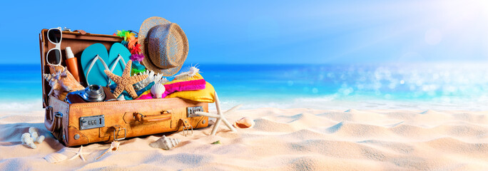 Beach Preparation - Accessories In Suitcase On Sand
