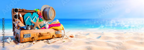 Foto Murales Beach Preparation - Accessories In Suitcase On Sand