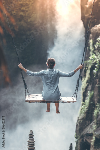 Beautiful woman swings near waterfall in the jungle of Bali island, Indonesia. - 206422885