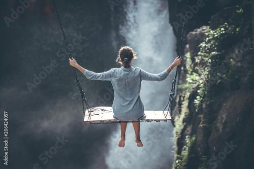 Beautiful woman swings near waterfall in the jungle of Bali island, Indonesia. - 206424057