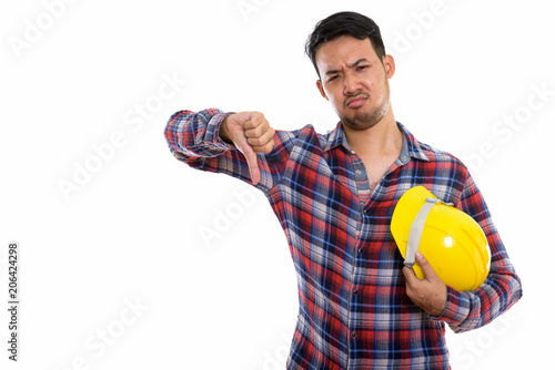 Studio shot of young Asian man construction worker holding safet
