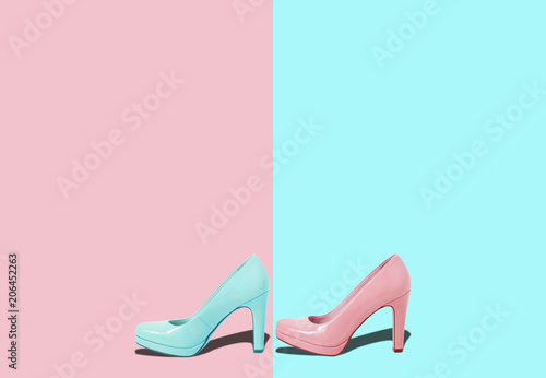 Leinwanddruck Bild Fashion female pink shoes with heels. Women's footwear casual design isolated on blue background with free space for text.