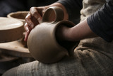 Professional female potter working with clay  - 206454268