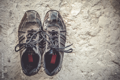 Old Sneakers Of Black Color Stand On A Concrete Floor Top View Copy Space