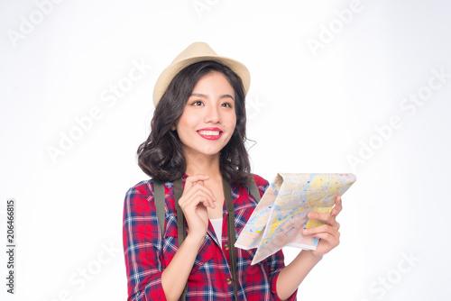 Woman travel. Young beautiful asian woman traveler watching map standing over white.