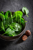 Healthy green spinach on gray old stone - 206501011