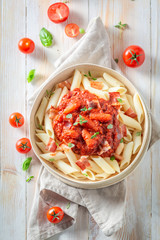 Delicious penne bolognese made of fresh tomatoes © shaiith
