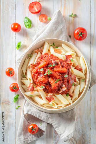 Delicious penne bolognese made of fresh tomatoes - 206501077