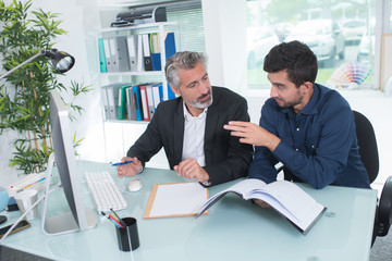 man talking to her co-worker at workplace