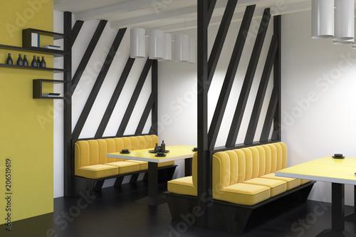 Leinwanddruck Bild Yellow sofas diner interior side view