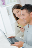 couple with laptop and credit card in living room - 206522831