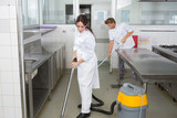 Workers cleaning kitchen floor - 206524086