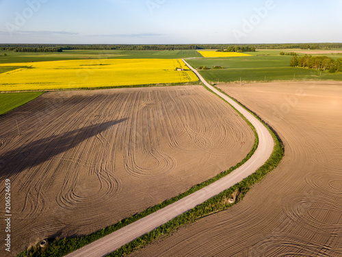 Fotobehang Oranje drone image. aerial view of rural area with fields and road infrastructure