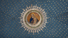 "Постер, картина, фотообои ""Virgin Mary with child Jesus painted on the starry ceiling inside the Gothic-Renaissance cathedral."""