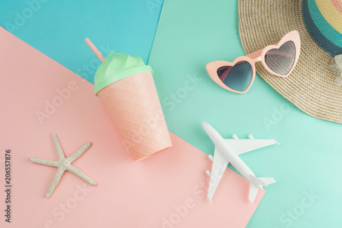 Women's accessories items on pastel colors background, Summer vacation concept