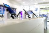 Close up of cell phones or mobile phones on display in a modern, clean and contemporary shop or mall - 206575290