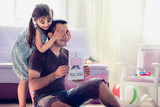 Happy Father's Day Concept. Child Daughter Hiding Surprise Postcard Present for Her Dad. - 206595057