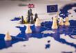 Chess pieces over an european map. Brexit concept