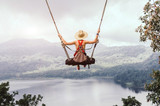 Carefree woman on the swing on a inspiring landscape. - 206613616