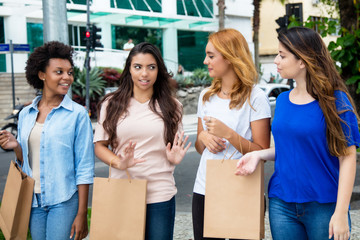 Group of women with shopping bags in front of shopping mall