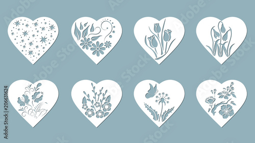 Fototapeta Set stencil hearts with Tulip, snowdrop, flower, butterfly, flower, star. Template for interior design, invitations, etc. Image suitable for laser cutting, plotter cutting or printing.