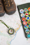 Hiking boots compass and sash on map - 206647028