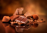 Chocolate. Assorted chocolate sweets and candies over dark background. Confectionery - 206662876