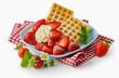 Fresh ripe strawberries with waffles and cream