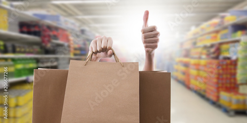 shopping bags with sign of satisfaction and okay